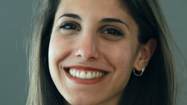 close up of smiling woman looking into the camera - gente comune video stock e b–roll