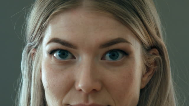 close up of smiling woman looking into the camera - blue eyes stock videos and b-roll footage