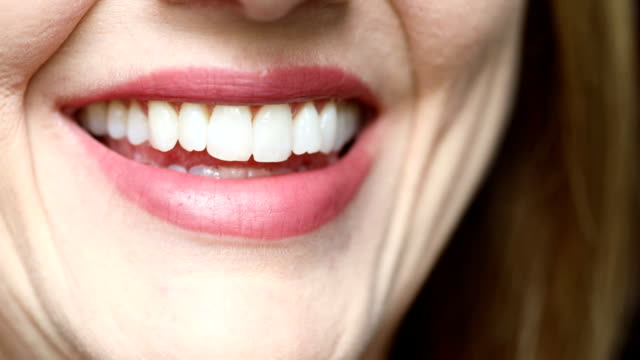 close up of smiling woman - toothy smile stock videos & royalty-free footage
