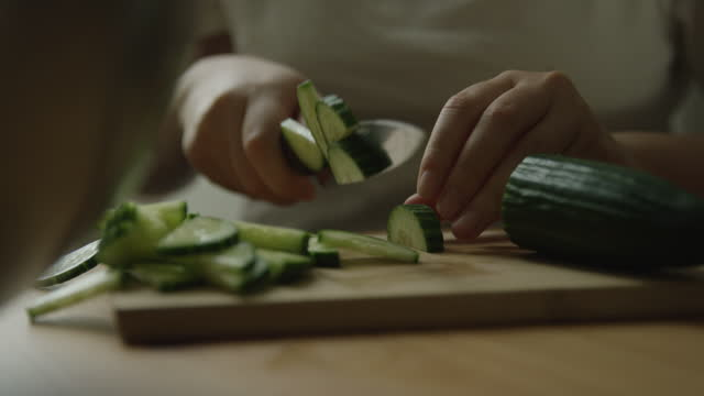 close up of someone cutting a cucumber - organic stock videos & royalty-free footage