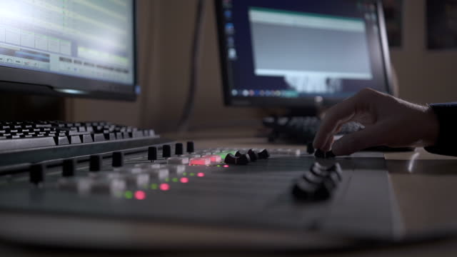 close up of sound mixing console - pannello di controllo video stock e b–roll