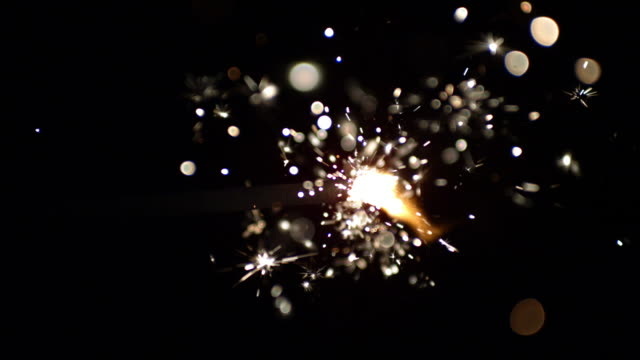 close up of sparks flying from burning fuse - 10 sekunden oder länger stock-videos und b-roll-filmmaterial