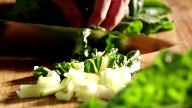 close up of spinach being cut - vegetable stock videos & royalty-free footage
