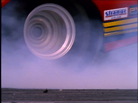 close up of spinning tire of race car / takes off - wheel stock videos & royalty-free footage