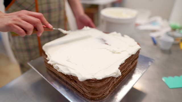 close up of spreading cream on a cake - whipped cream stock videos & royalty-free footage