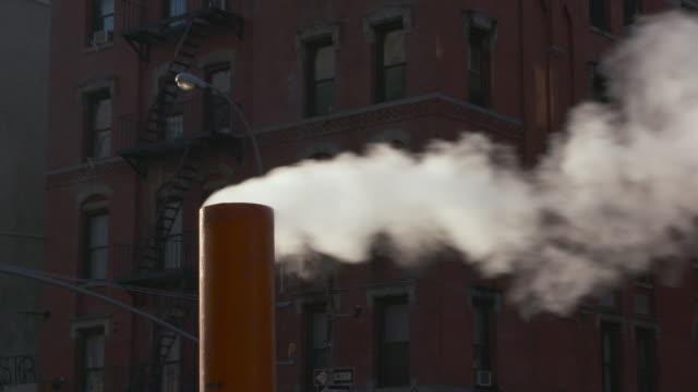 close up of steam rising from orange cone on new york city street. - 非常階段点の映像素材/bロール
