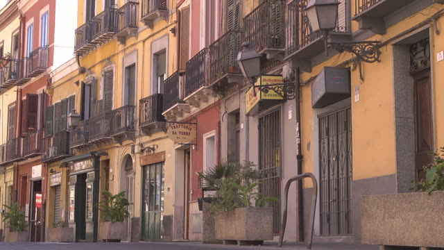 close up of street with coloured historic houses - sardinia stock videos & royalty-free footage
