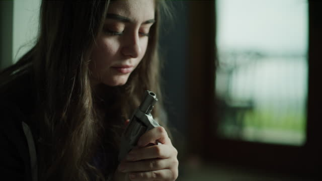 close up of suicidal girl pointing handgun at chin then crying / cedar hills, utah, united states - gereiztheit stock-videos und b-roll-filmmaterial