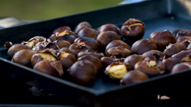 close up of sweet chestnuts on baking tray - baking tray stock videos & royalty-free footage