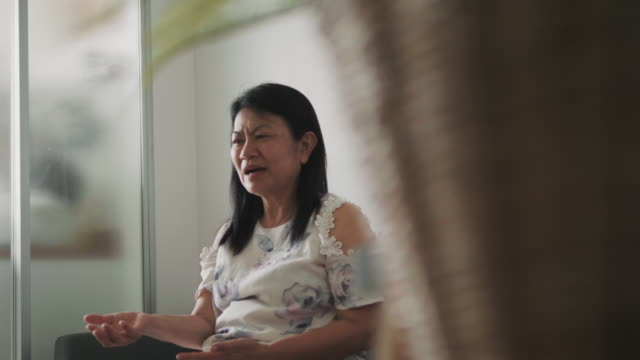 Close up of Thai grandmother is talking and singing song to teaching her grandson