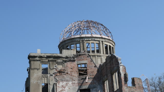close up of the a-bomb dome at the hiroshima peace memorial - 大量破壊兵器点の映像素材/bロール