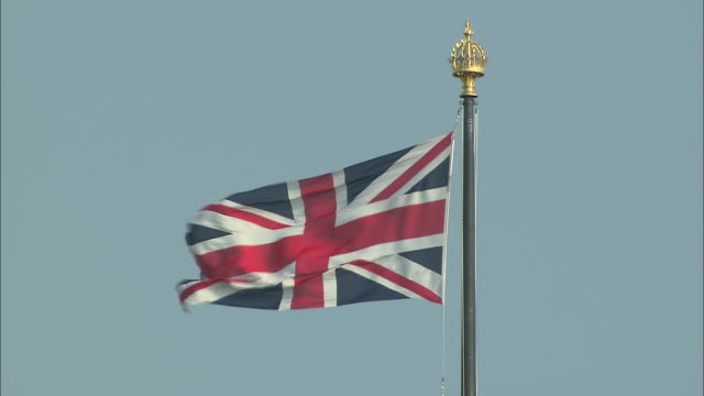 close up of the british flag waving in the wind in london, england. - music or celebrities or fashion or film industry or film premiere or youth culture or novelty item or vacations stock videos & royalty-free footage