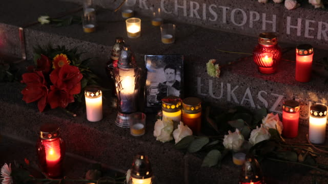 Close up of the commemorative photo of the truck driver murdered by the terrorist from Poland Candles and flowers lie among the names of victims at a...