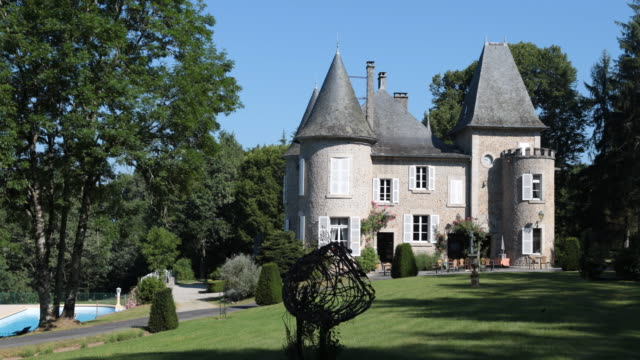 vidéos et rushes de close up of the domaine de mialaret in neuvic at the massif central france a castle from the 19th century in the middle of beautiful nature where... - château