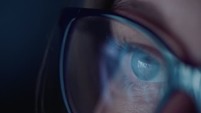 close up of the eye of a young woman as she watches a video, with the screen reflected in her eye on november 4, 2020 in bristol, uk. - only women stock videos & royalty-free footage
