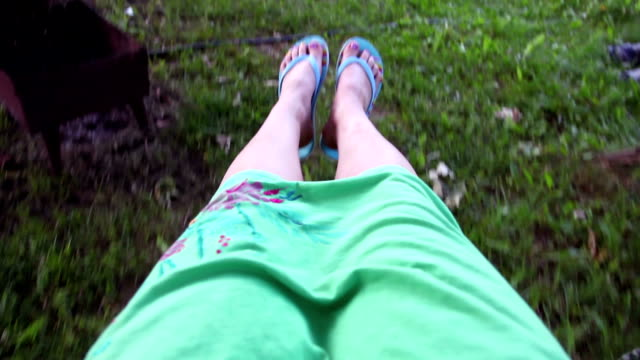 close up of the girl's feet riding on the swing - swinging stock videos & royalty-free footage