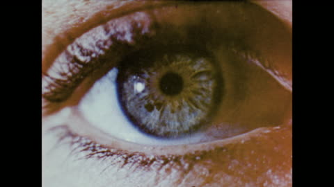 1958 close up of the human eye as narrator explains how each part of the eye works - archivmaterial stock-videos und b-roll-filmmaterial
