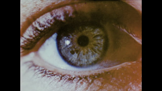 1958 close up of the human eye as narrator explains how each part of the eye works - di archivio video stock e b–roll