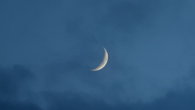 close up of the moon in the blue evening sky - crescent stock videos & royalty-free footage