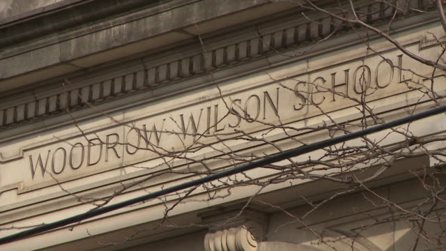 close up of the stone sign woodrow wilson school in new jersey - western script stock videos & royalty-free footage