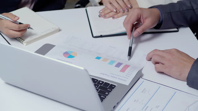 close up of three business people meeting and planning strategy and brainstorming at office together.finance and economy, business concept. - risk stock videos & royalty-free footage