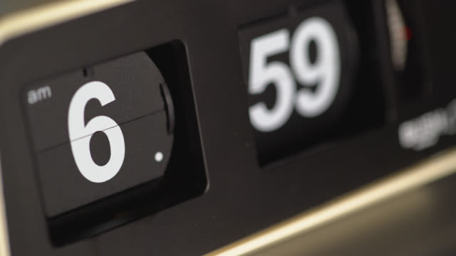 Close up of time display changing on a flip clock