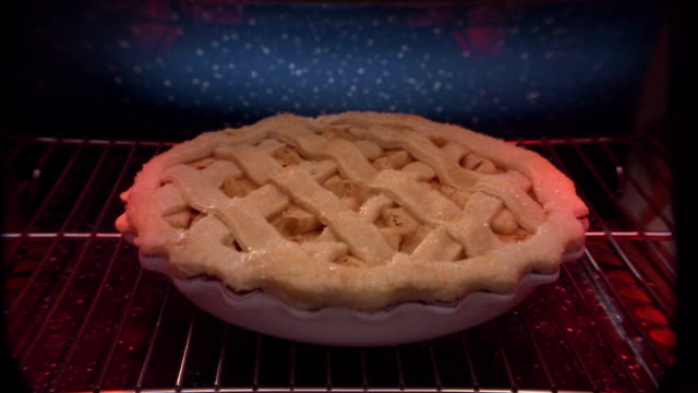 Close up of time lapse apple pie rising and baking in oven