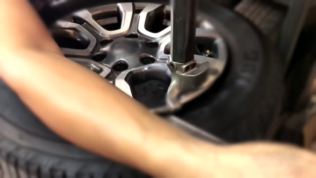 Close up of Tire changing at car service