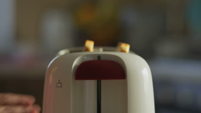 close up of toast bread in toaster - toaster appliance stock videos & royalty-free footage