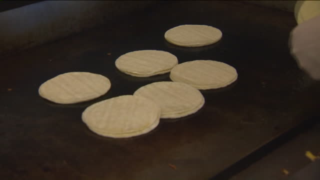 close- up of tortillas on stove - tortilla flatbread stock videos & royalty-free footage