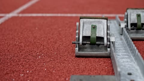 close up of track starting block at track field. - track and field stock videos & royalty-free footage