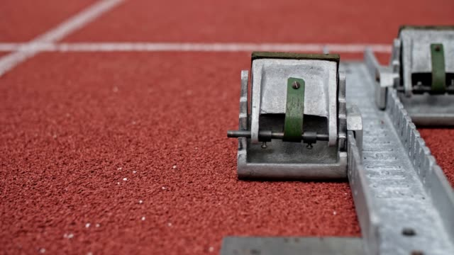 close up of track starting block at track field. - stadium stock videos & royalty-free footage