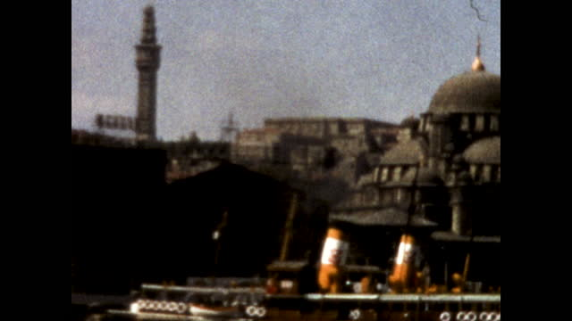 close up of turkish hagia sophia cathedral across the river; ships docked at the edge of the river; black smoke at the end of the clip - 1960 1969 stock videos & royalty-free footage