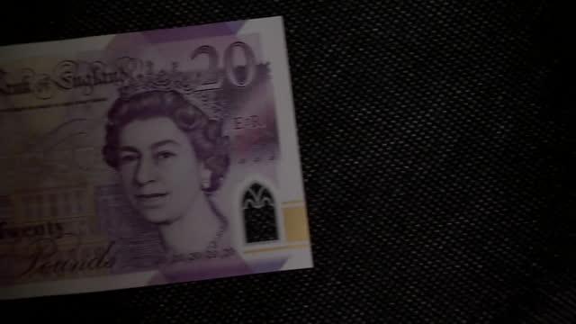 "close up of twenty pound note - ""bbc news"" stock videos & royalty-free footage"