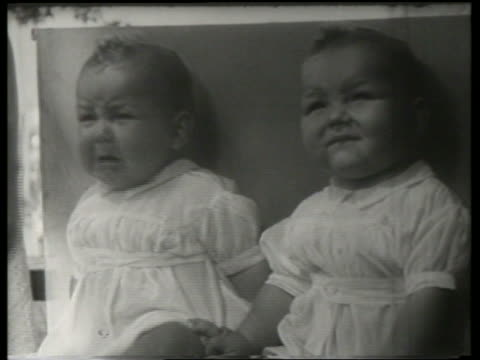 close up of twin babies / 1 crying / canadian national exhibition / sound - babies only stock videos & royalty-free footage