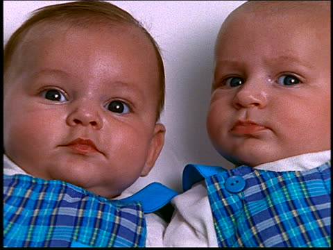close up of twin baby boys