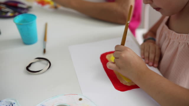 close up  of two girls painting on the art class - art class stock videos & royalty-free footage