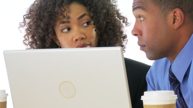 close up of two people businesspeople looking at computer screen - examination gown stock videos and b-roll footage