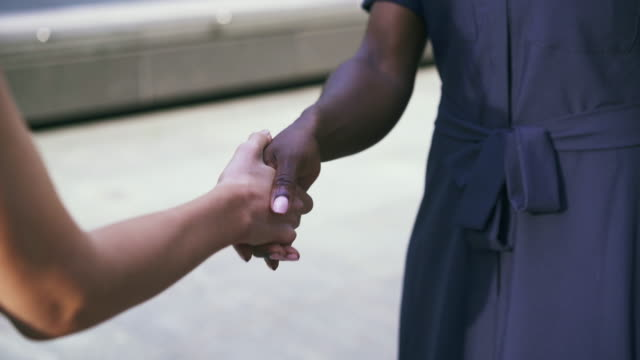 close up of two women shaking hands (two angles) - handshake stock videos & royalty-free footage
