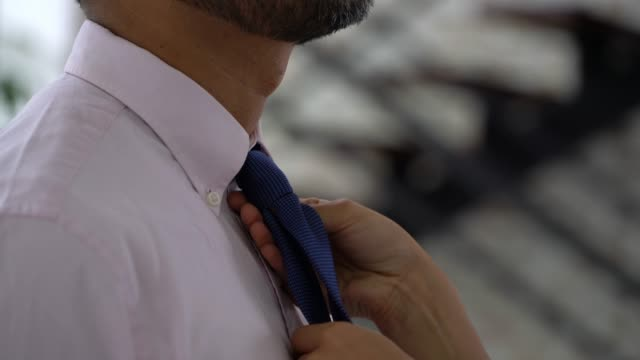 close up of unrecognisable woman tying partner's necktie - necktie stock videos & royalty-free footage