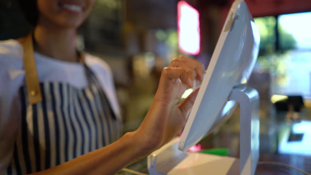 close up of unrecognizable female waitress registering an order on system - serving staff stock videos & royalty-free footage