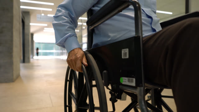 close up of unrecognizable man on wheelchair at the hospital - unrecognizable person stock videos & royalty-free footage