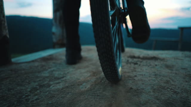 close up  of unrecognizable  man spinning back wheel of his mountain bicycle on dirt ground. - bmx cycling stock videos and b-roll footage