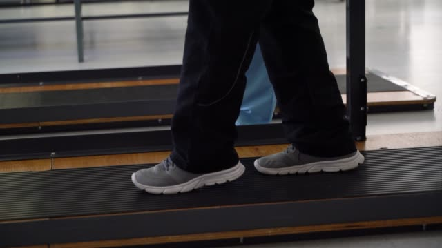 close up of unrecognizable patient walking slowly with the help of parallel bars - physical therapy stock videos & royalty-free footage
