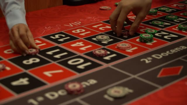 close up of unrecognizable people placing bets on roulette table - roulette stock videos and b-roll footage