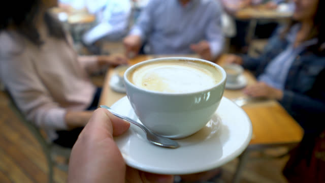 close up of unrecognizable waiter carrying a cappuccino for a customer - colombian ethnicity stock videos & royalty-free footage