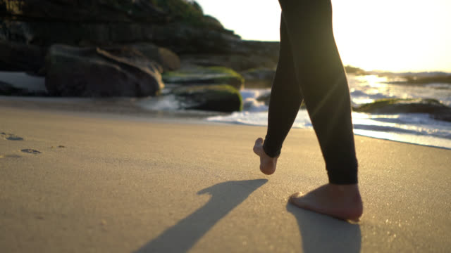 close up of unrecognizable woman walking barefoot at the beach - walking stock videos & royalty-free footage