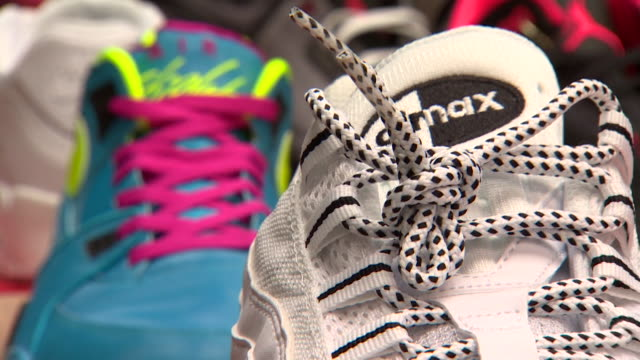 close up of various trainers on display at sneaker convention in london - variation stock videos & royalty-free footage