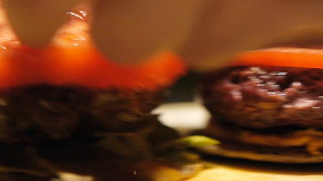 close up of vegetarian burger preparation . healthy food. - vegan food stock videos & royalty-free footage
