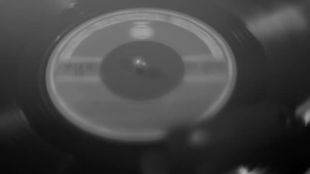 close up of vinyl record spinning on turntable - disk stock videos & royalty-free footage